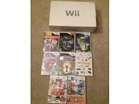 Boxed white Nintendo Wii and games