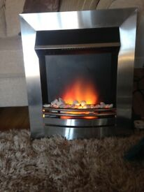 silver electric fire with pebbles