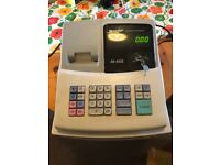 Cash register with lots of spare till rolls