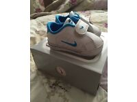 First size Nike trainers