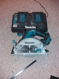 DHS680Z makita circular saw and twin charger both only a month old and been used a few times