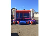 Adult boxing bouncy castle with gloves, head guards and blower