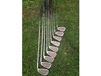 Set of golf clubs, driver, woods and putter