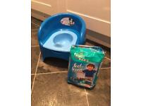 Blue Mickey Mouse potty (hardly used) and unoped Pampers potty training pull up nappies
