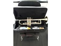 Elkhart 100TR Bb Student trumpet with accessories and additional moutpiece, mute and tutor book.