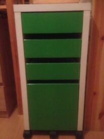 White and green filing cabinet for sale.