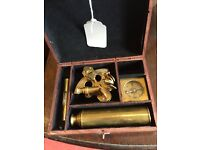 Antique brass sextant with accessories