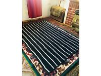 Black and with lines rug washable clean condition.