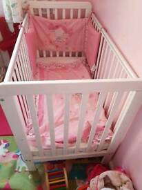 White cot with bedding