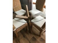 Habitat Glass dining table with 4 Rattan Chairs