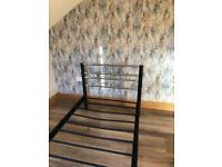 Single Black Framed Bed