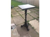 CAST IRON TABLE WITH A SQUARE SLATE TOP