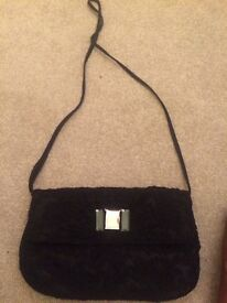 Black lace handbag with jewelled decoration, long strap £3