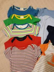 Bundle of new baby bodysuits