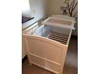 White cot bed and cot top changer