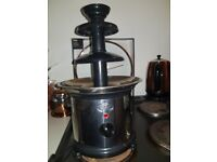Chocolate fountain used once excellent condition paid £50 box is a bit damaged through storage