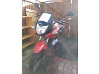 Red Honda CBF125, 2009, only 13800 miles, new gearbox, MoT until July, includes bike cover and lock