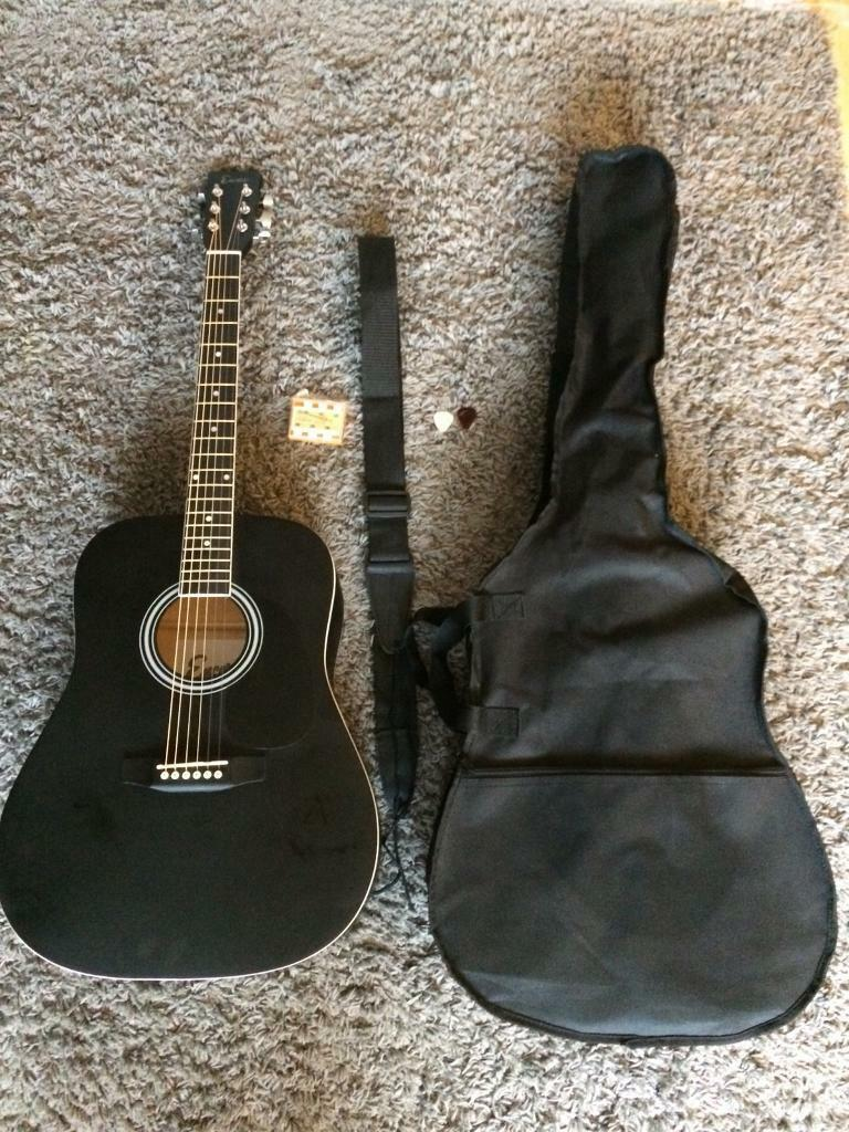 Acoustic guitar with extras new condition