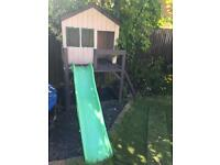 Wooden playhouse with slide - SOLD