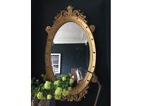 Large wall hung oval gilt mirror