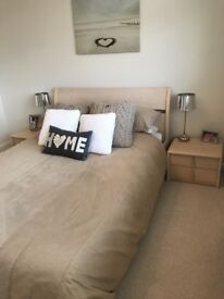 Queen size bed and mattress, 2 bedside tables, chest of drawers and wardrobes, light wood.