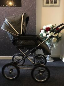 Sliver cross sleep over pram in cadet grey and simplicity car seat and base