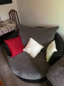 Black and grey swivel chair, as new.