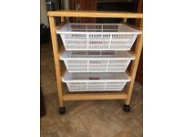 Vegetable storage trolly on casters