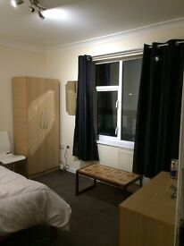 Large double room in Ashford Staines Feltham borders Heathrow Terminal 4. Bills included