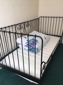 Single black frame day bed
