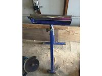 Rollerball height adjustable stand and roller height adjustable stand