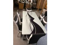 Brand new flat packed dinning table with 6 chairs is for available with cash on delivery