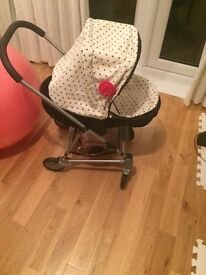 Girls pram. Black and cream with red bow. Really good condition