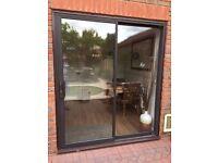 Aluminium sliding brown patio doors with additional locks
