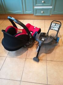 Britax baby carrier and belt secured car seat base.