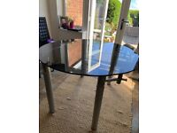 Glass dining table with expansion sides