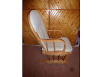 Light wood rocking chair with cream cushion