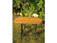 Garden Table. Vintage Singer Sewing Machine base with solid wood stained Top