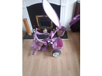 Kids pink push along bike. Hardly used. In excellent condition. For Collection.