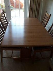 Ercol extendable dining table and 4 upholstered Ercol dining chairs