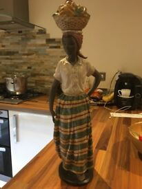 NAO Daisa statuette of Carribean woman carrying fruit on her head