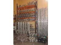 Large collection of Milos trio heavy duty 290 Truss, Gantry with lighting, storage & trolleys.