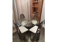 4 seater glass dining table and chairs