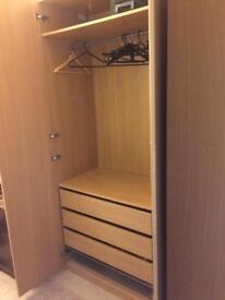 Pair of large oak colour Ikea wardrobes