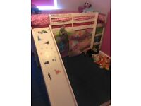 Children bed with a slide almost very new. (2) single bed) 6 months
