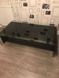 Solid glass coffee table / matching next tables