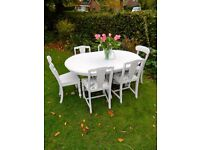 Circular extending shabby chic dining table and 6 chairs