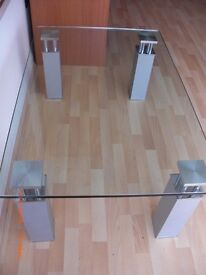 GLASS COFFEE TABLE WITH SILVER MATT FINISHED LEGS IN VERY GOOD CONDITION