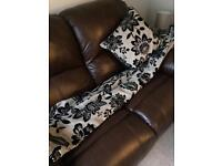 Brown and black Dunelm curtains and cushion