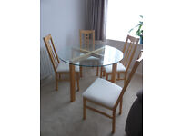 Glass & Birch Dining Table and matching 4 Birch and Cream Dining Chairs from IKEA